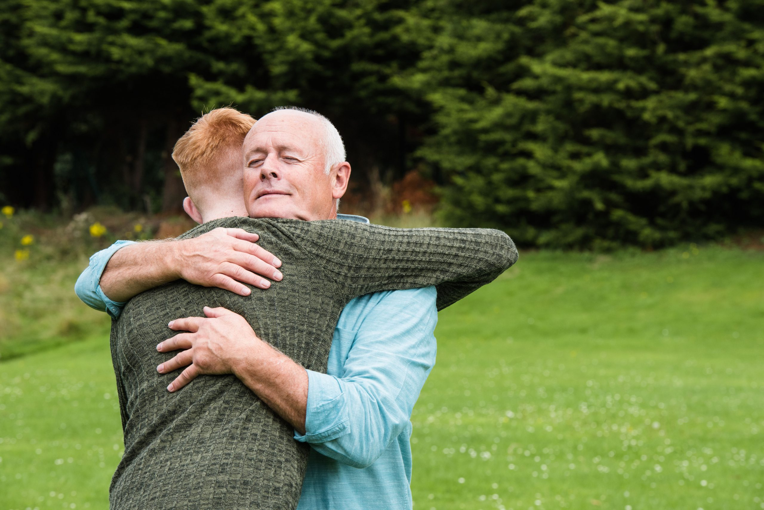 warm embrace male foster carer
